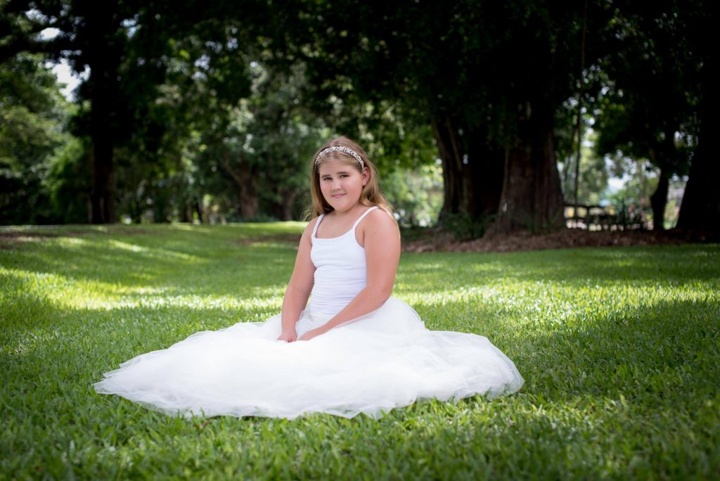 Young girl sitting in Tulle Skirt - looks like a princess.